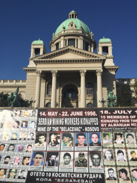 "A banner in front of the National Assembly of Serbia: ""Serbian Mining Workers Kidnapped"" (left) Belgrade. Marisa López"